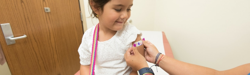 Girl getting vaccinated
